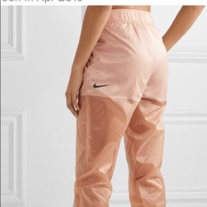 Nike Tech Pack Belted Shell Track Pants in Rose